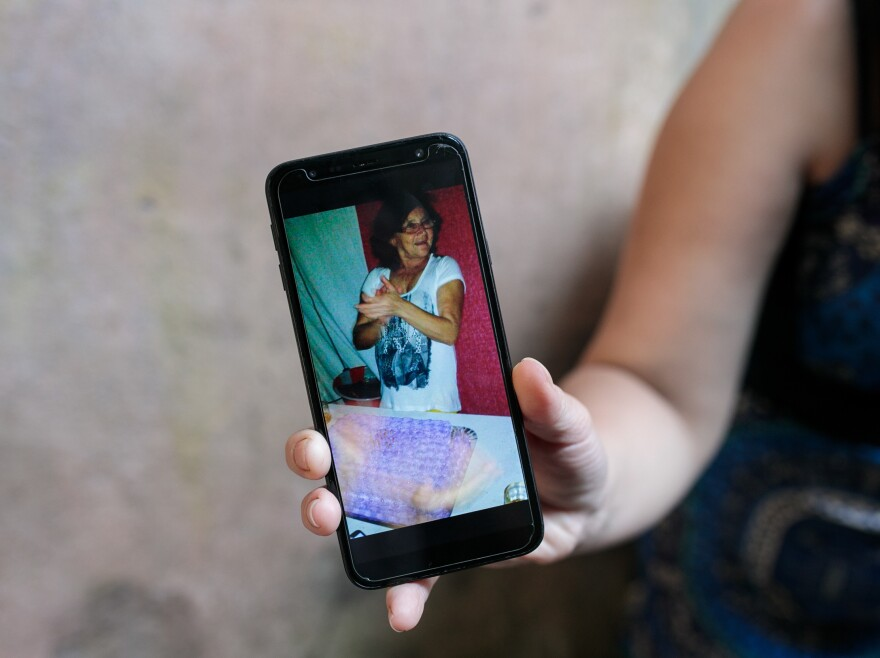 Fernandes de Andrade shows a photograph of her mother, who died from COVID-19 in April.