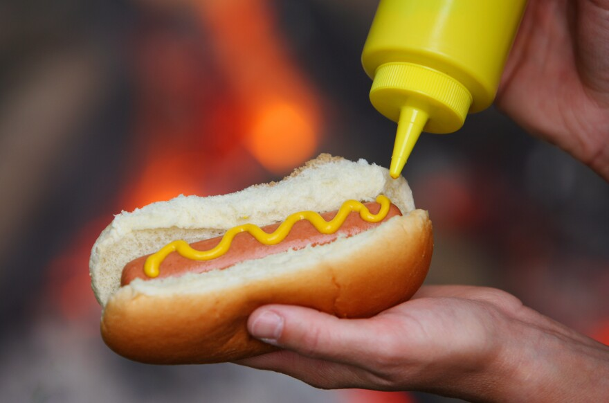 How many hot dogs are safe to eat? We tackle your questions about an expert panel's conclusion that processed meats are carcinogenic.
