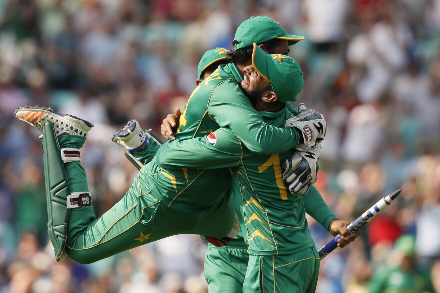 Pakistan's captain, Sarfraz Ahmed, gives a teammate a leaping hug defeating India in the ICC Champions Trophy final in London on Sunday.