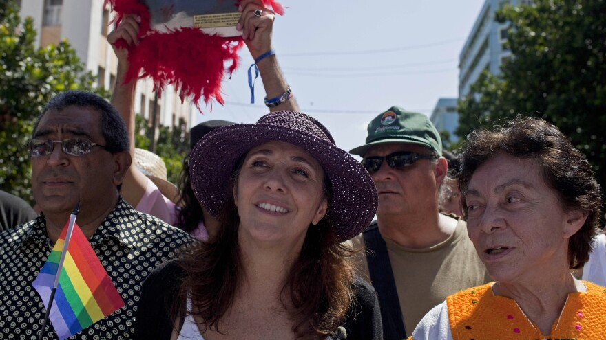In what could be a first, Mariela Castro (center), daughter of Cuban President Raul Castro, voted against legislation in the country's parliament. In May, she marched in a parade for the International Day Against Homophobia in Havana.