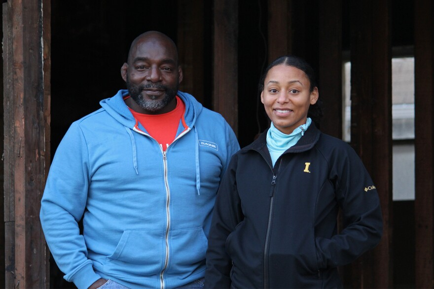 Curtis White and his daughter, Jasmine Brooks, stand on the back porch of a house he is renovating in Des Moines. White shares business advice with Brooks, who has followed in his footsteps as a homebuilder.