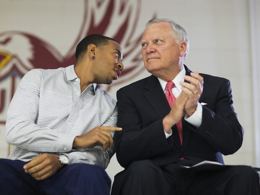 Republican Gov. Nathan Deal visits a charter school in Riverdale, Ga., with rapper Ludacris.
