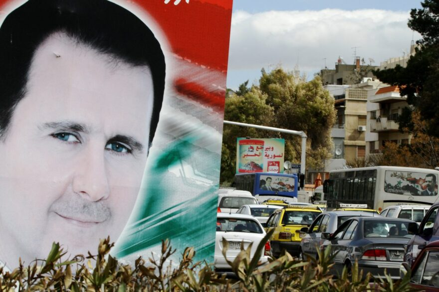 A banner bearing a portrait of Syrian President Bashar al-Assad in a street in the city of Damascus. (Louai Beshara/AFP/Getty Images)