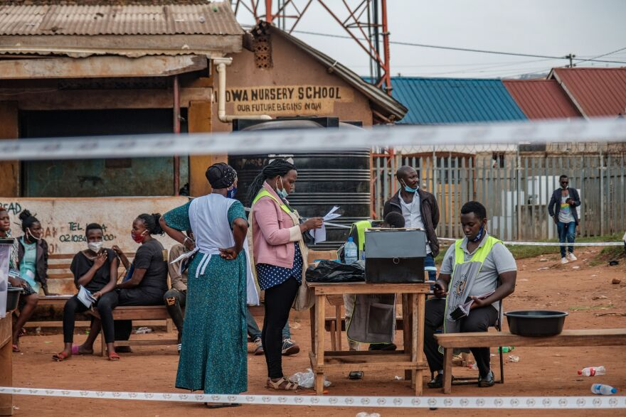 Ugandan electoral commission officials count ballot papers after the polls closed at a polling station in Kampala, Uganda, on January 14, 2021.