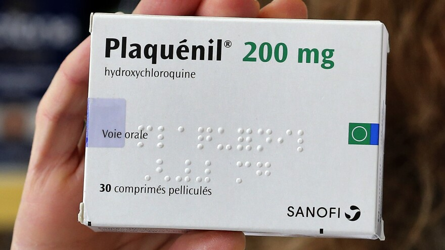 The move comes after the World Health Organization halted clinical trials of the drug as a treatment, citing a study that found no benefit and a higher mortality rate for hospitalized patients. A box of hydroxychloroquine, under the brand name Plaquenil, is seen in a pharmacy in Paris.