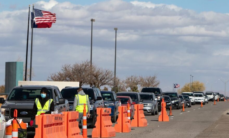 Cars wait in long lines at the city of El Paso's COVID-19 vaccination site near the airport. The need to have transportation to reach the site is one of the sources of inequity in vaccine distribution.