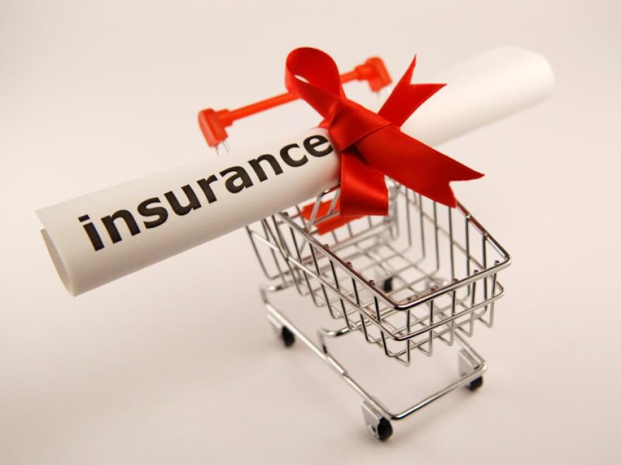 insurance in a shopping cart.