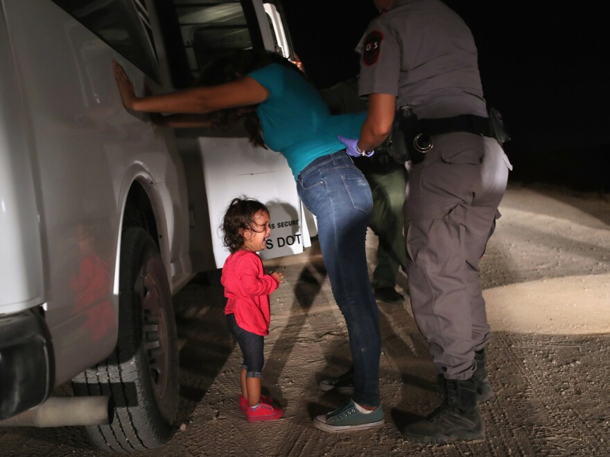 A child cries as her mother is searched near the U.S.-Mexico border in June 2018. During the two and a half months the policy was in place, more than 3,000 children were separated from their families.