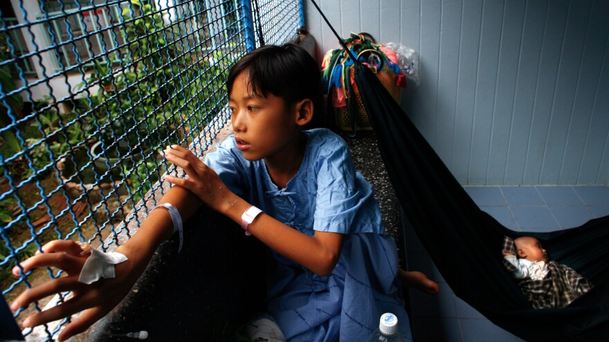 Kanu, 13, is treated for hepatitis at a hospital in Thailand.