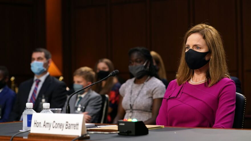 Judge Amy Coney Barrett, President Trump's Supreme Court nominee, attends the first day of her Senate confirmation hearing on Capitol Hill on Monday.