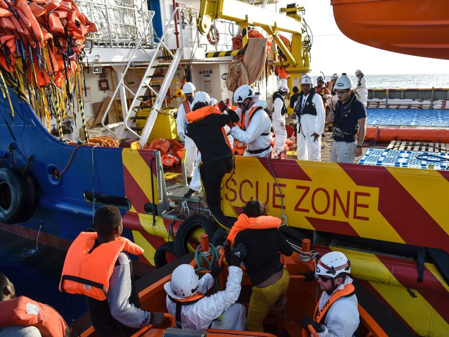 People board a rescue ship off the Libyan coast in the Mediterranean Sea on Thursday.