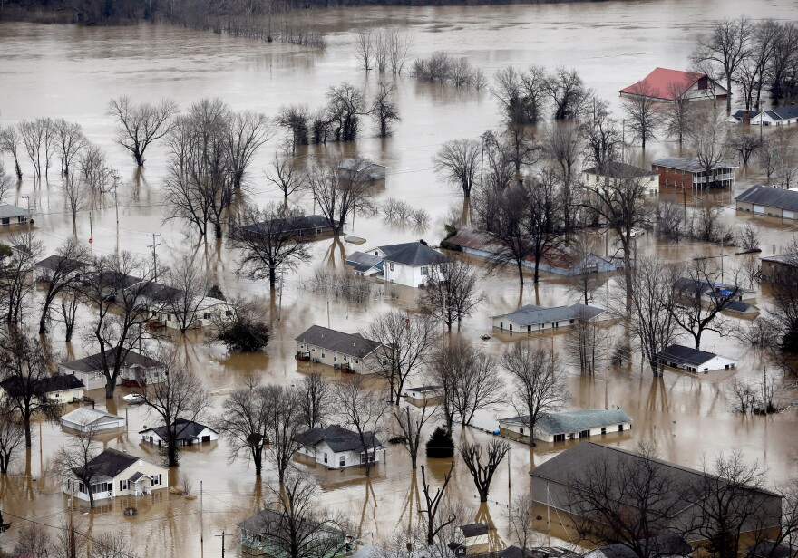 Homes in Pacific, Mo., are surrounded by floodwaters on Wednesday. A rare winter flood threatened nearly two dozen federal levees in Missouri and Illinois on Wednesday as rivers rose, prompting evacuations in several places.