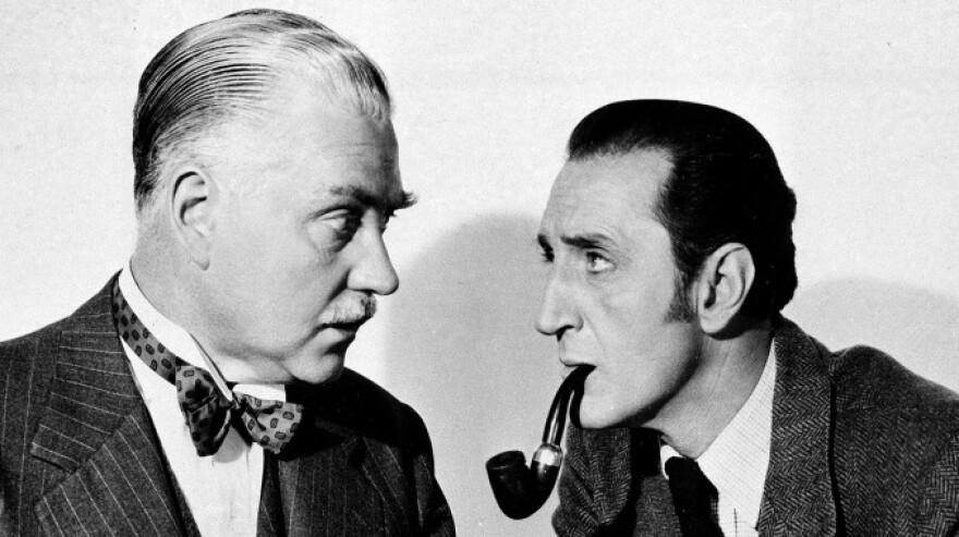 Basil Rathbone (right) as Sherlock Holmes and Nigel Bruce as Dr. Watson in <em>The Adventures of Sherlock Holmes</em>, 1945.