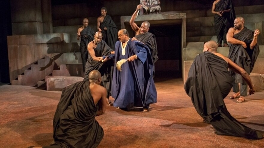 Julius Caesar (Jeffery Kissoon) is attacked by members of the Senate in the Royal Shakespeare Company's production of the play.