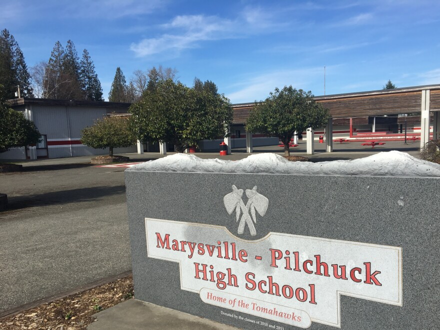 Marysville Pilchuck High School, north of Seattle. In October 2014, a freshman shot five students in the cafeteria, visible in the background. It has been locked and off-limits since the shooting.