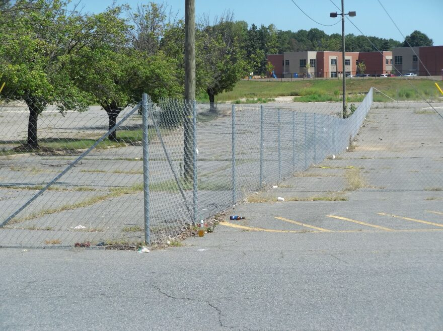 The former Eastland Mall site is now just empty parking lots and fences.