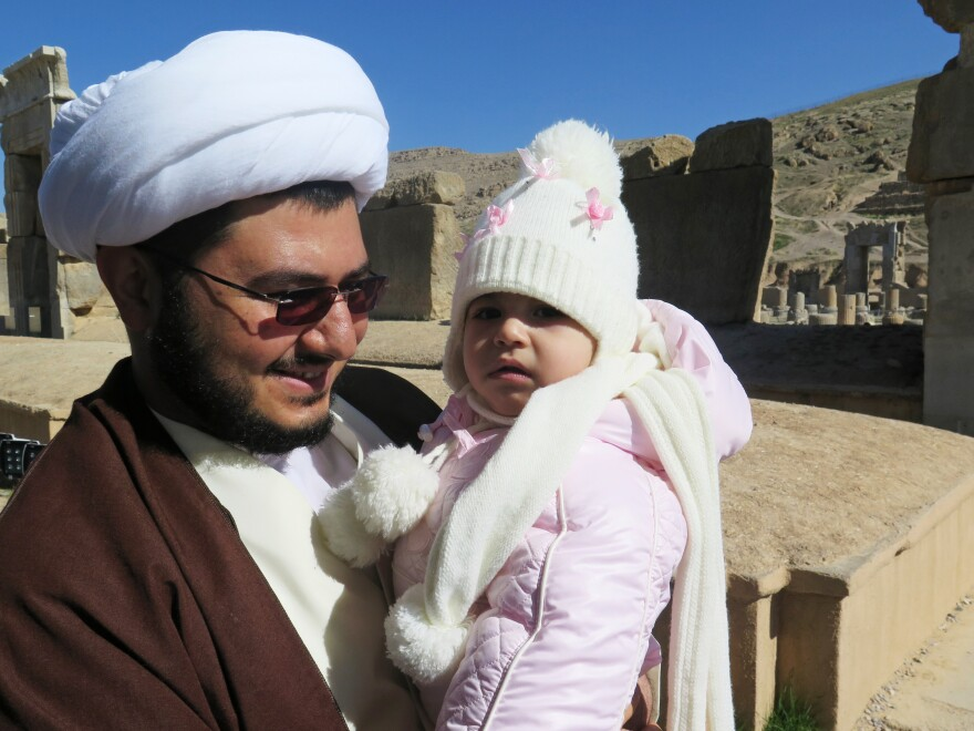 "Mohammad Reza Mahdian, holding his year-old daughter, brought his family to visit Persepolis. The site is a reminder, he says, that ""nothing will remain but [rulers'] good works."""