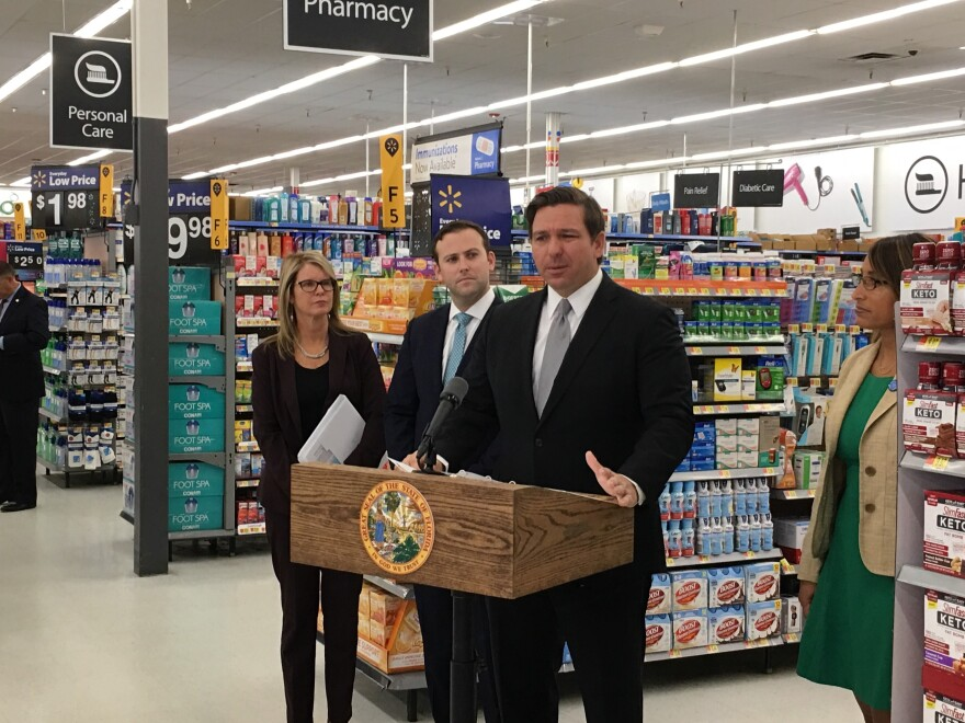 Gov. Ron DeSantis speaks in a Palm Harbor Walmart about the launch of a health care price transparency website.