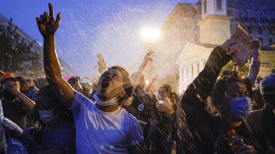 Demonstrators protest police violence near the White House on Thursday.