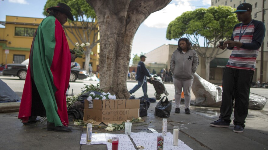 People view a memorial to a man killed by police on Skid Row in Los Angeles. The police say two officers who were at the scene were wearing body cameras.