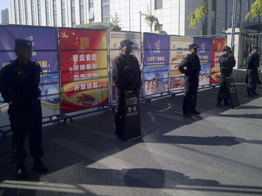 Policemen in riot gear guard a checkpoint on a road near a courthouse where ethnic Uighur academic Ilham Tohti's trial was taking place in Urumqi, Xinjiang, last week. Tohti, an economics professor, is accused of promoting Xinjiang's independence from China.