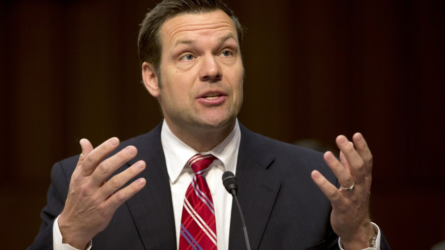 Kansas Secretary of State Kris Kobach testifies before the Senate Judiciary Committee hearing on immigration reform in Washington, D.C., in April. Kobach's challenger, Democrat Jean Schodorf, promises to stay closer to Kansas.