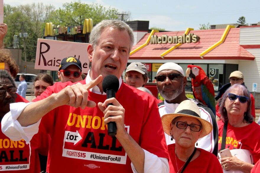 New York City mayor Bill de Blasio, speaks to protestors outside a McDonald's in Des Moines. The Democratic presidential candidate said he supports making $15-per-hour the national minimum wage.