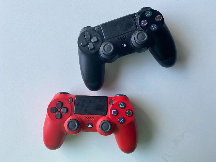 Photo of a red and black playstation controller