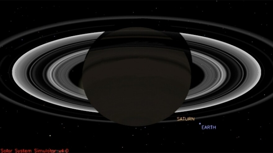 That little blue dot is how Earth will likely appear in a photo shot from a spacecraft that is studying Saturn.