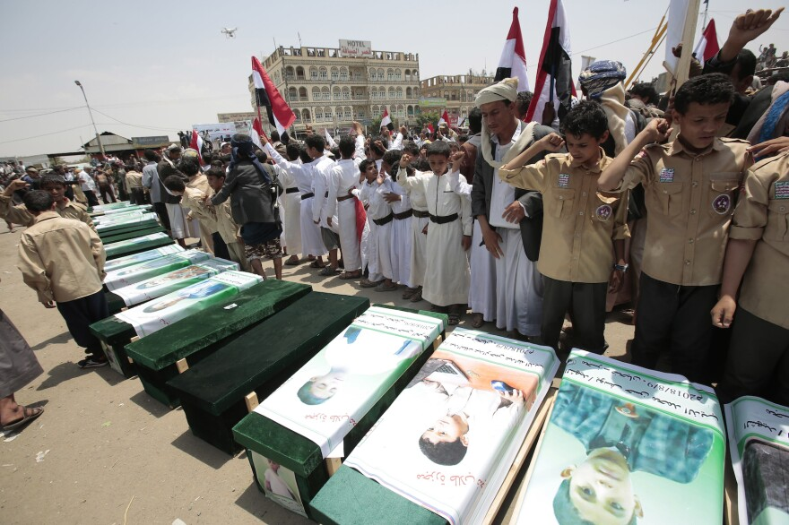 Yemeni people attend the funeral of victims of a Saudi-led airstrike, in Saada, Yemen, Monday, Aug. 13, 2018. Yemen's shiite rebels are backing a United Nations' call for an investigation into the airstrike in the country's north that killed dozens of people including many children. (Hani Mohammed/AP)