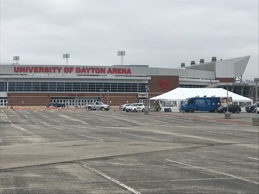 Cars line up for drive-through COVID-19 tests at the University of Dayton Arena.