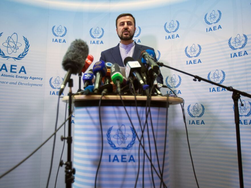 Iran's Permanent Representative to the United Nations Kazem Gharib Abadi speaks with reporters after the International Atomic Energy Agency Board of Governors meeting in Vienna on Wednesday.