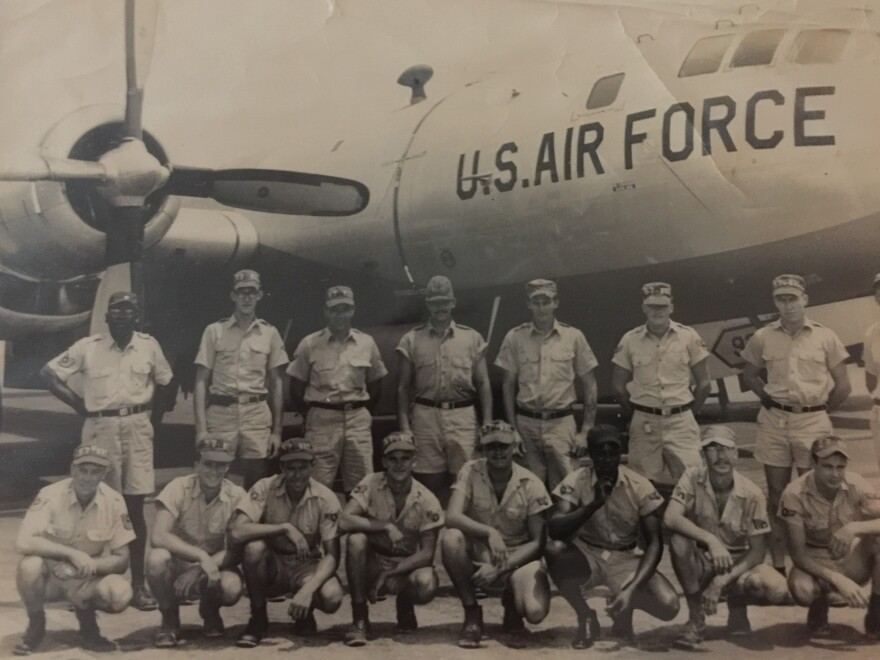 Tom Botchie (kneeling, 4th from left) is pictured with his fellow airmen on Enewetek Atoll. He said that during nuclear tests, they wore these uniforms with short pants and short sleeve shirts.