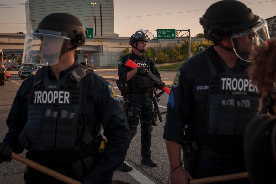 State police block protesters from continuing down Brentwood Blvd. toward Interstate 64 on Wednesday, Sept. 20, 2017 during a march in Richmond Heights.