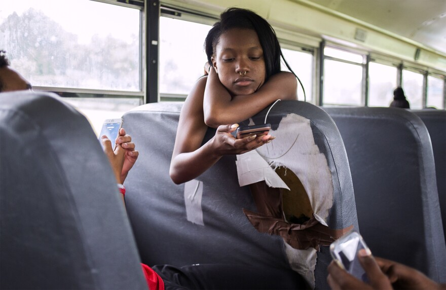 Mya Petty rides a Voluntary Interdistrict Choice Corporation bus back home from Parkway Central High School.