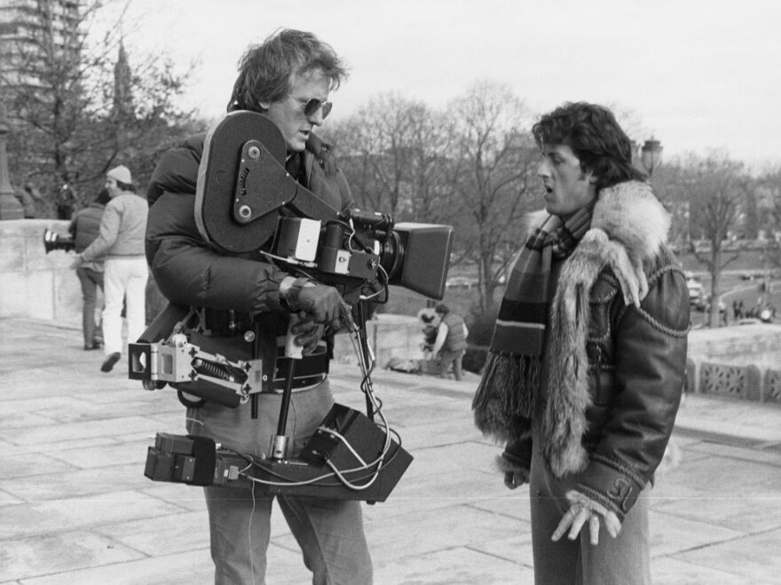 Garrett Brown with Sylvester Stallone during the filming of <em>Rocky II</em>.