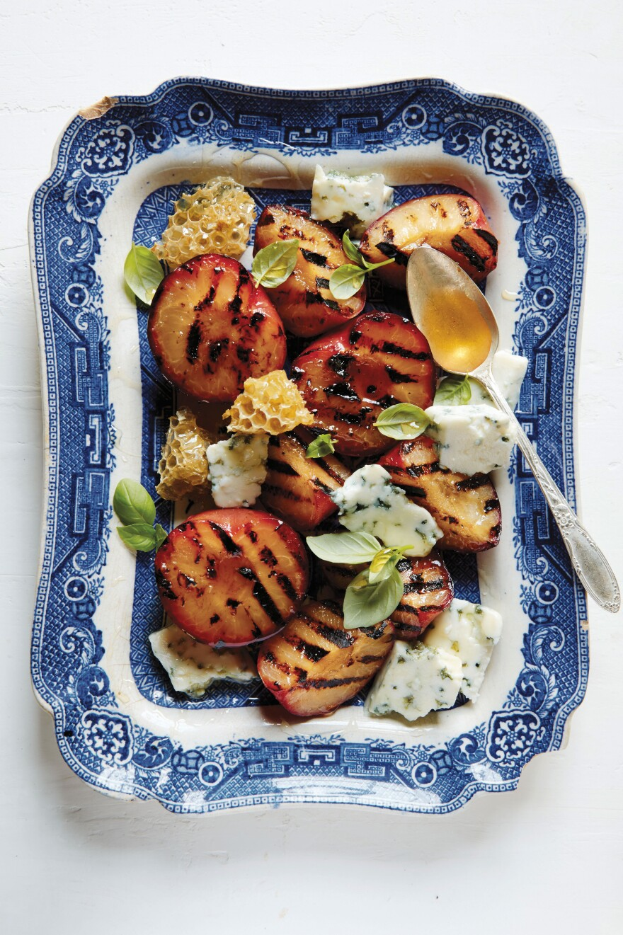 A grilled stone fruit, blue cheese and honey dish from The Lost Kitchen