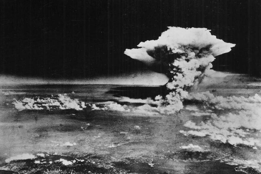 "A huge cloud resulting from the massive fires started by ""Little Boy,"" the atomic bomb dropped on Hiroshima, is photographed from a reconnaissance plane a few hours after the initial explosion."