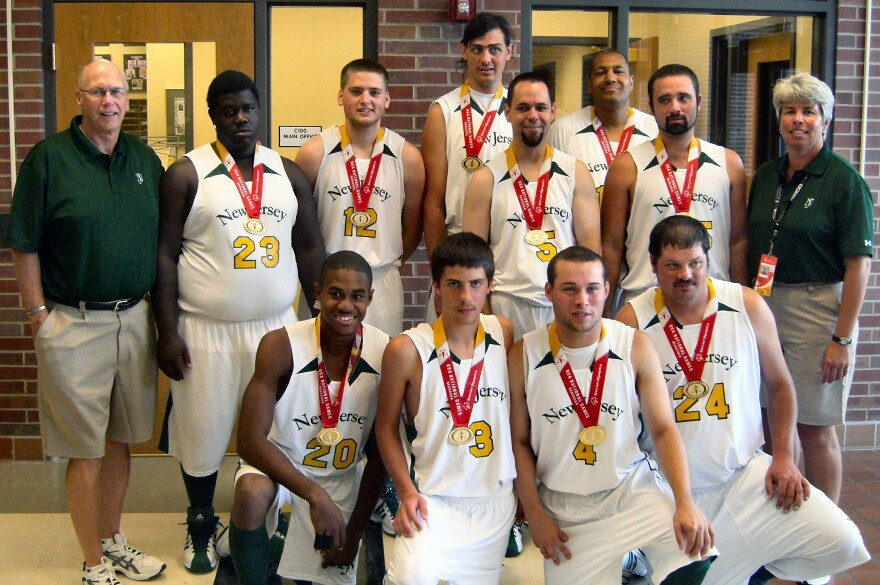 "<strong>Champions:</strong> The New Jersey basketball team --€"" including Jose Rodriguez (kneeling, second from right) --€"" poses for the cameras after winning the gold medal at the Special Olympics National Games in 2010."