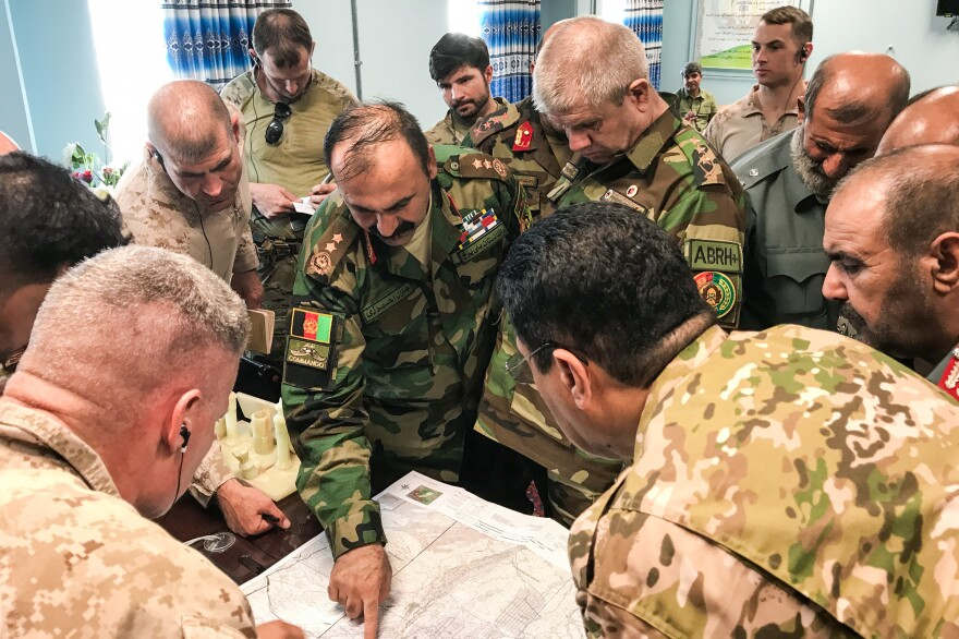 Afghan Major General Wali Mohammad Ahmadzai and his team plan operations against the Taliban with their American Marine counterparts in Helmand.