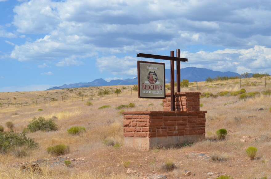 """A photo of a sign that reads """"Entering Redcliffs Desert Reserve."""""""
