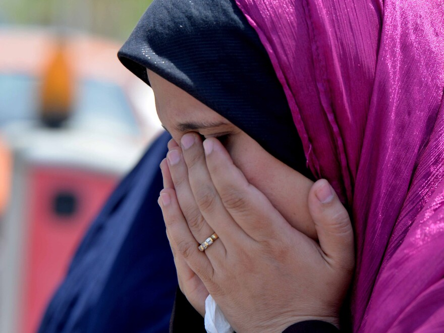 A relative of a passenger on EgyptAir Flight 804 cries at Cairo International Airport as she tries to get information about the plane's fate.