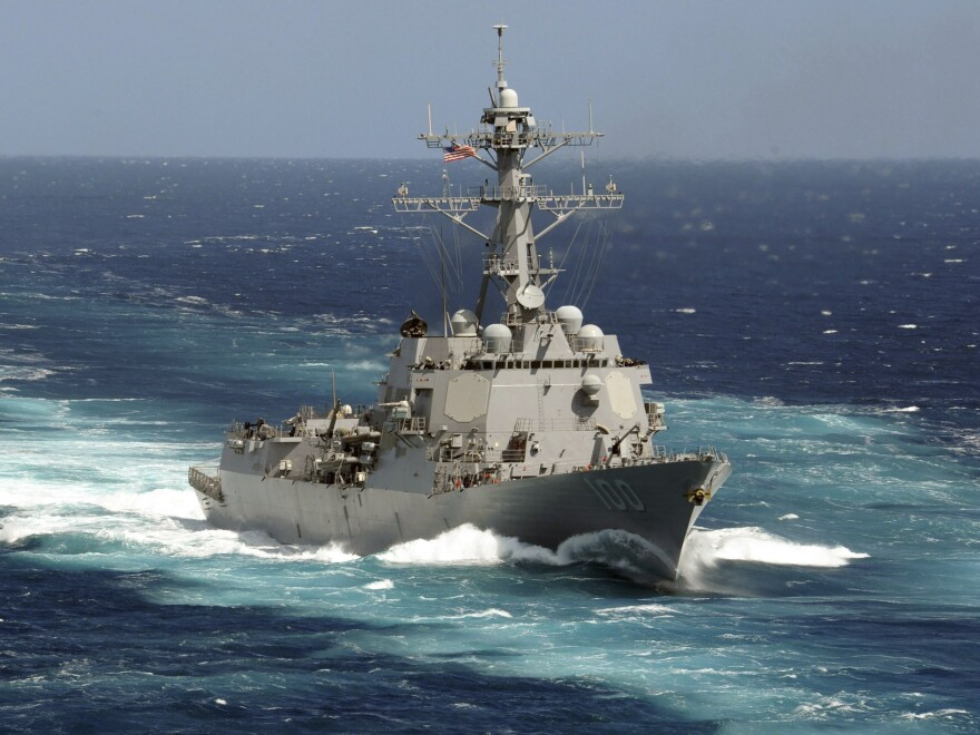 On Monday, the Navy said 47 crew members of the USS Kidd have tested positive for the coronavirus. This 2011 photo made available by the U.S. Navy shows the guided-missile destroyer in the Pacific Ocean.
