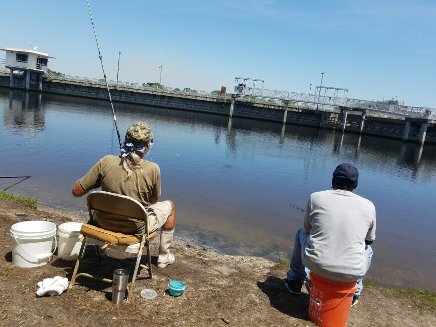 David Williams (l) and Alex Massie (r) have no problem eating the fish they catch from W.P. Franklin Lock, despite recent high levels of E. coli.