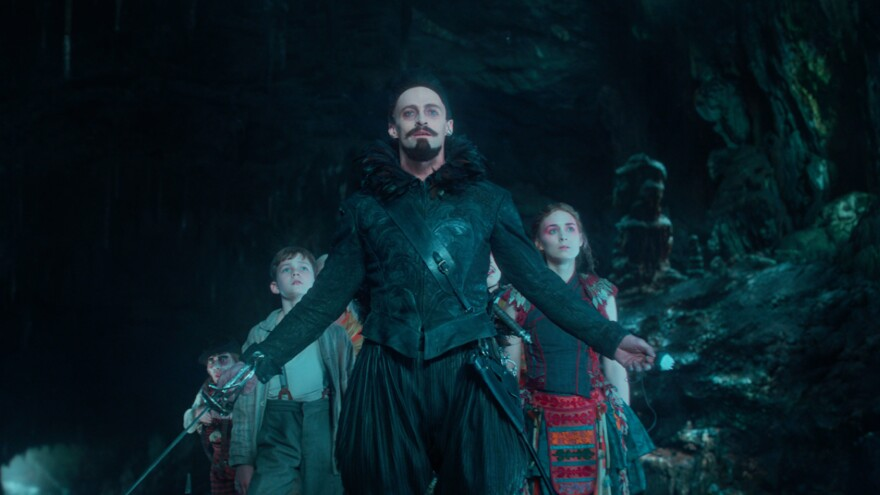 A 12-year-old Peter (Levi Miller), with the help of the warrior Tiger Lily (Rooney Mara), must defeat the pirate Blackbeard (Hugh Jackman) in <em>Pan</em>.