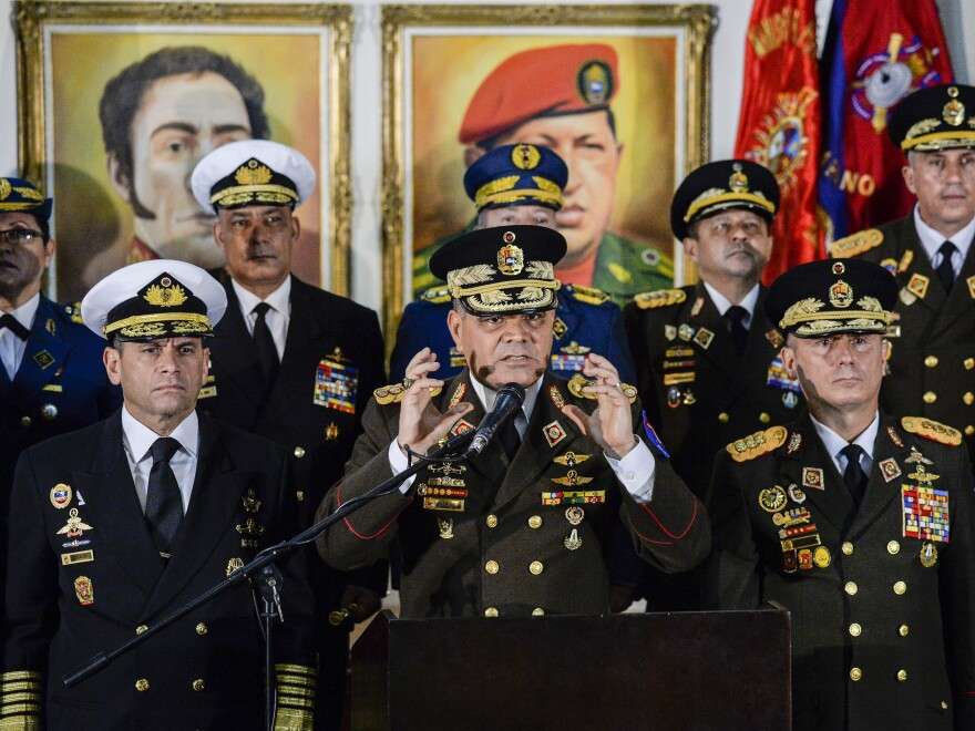 Flanked by other Venezuelan military leaders, Defense Minister Vladimir Padrino López expressed support for Nicolás Maduro on Thursday in the capital city, Caracas.
