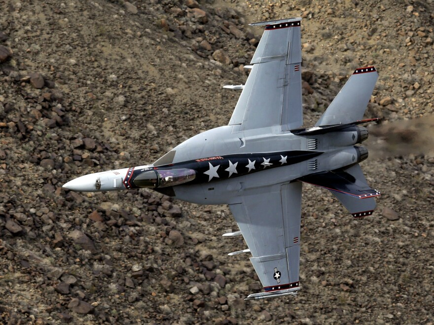 A U.S. Navy F/A-18E Super Hornet jet flies in Death Valley National Park, Calif. The crash occurred near the viewing area where park visitors watch pilots fly through a chasm known as Star Wars Canyon.