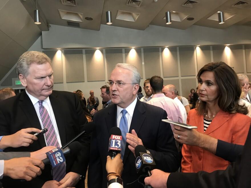 Three church officials speak to press.