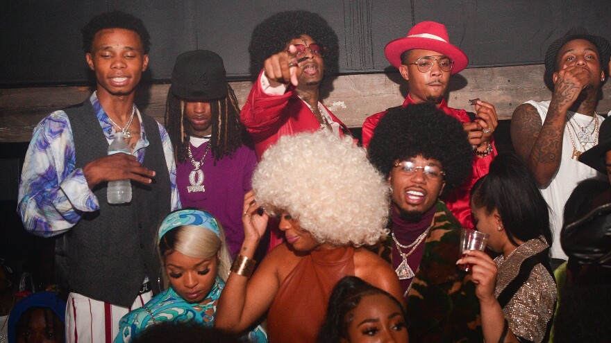 King Von (back row, second from left) pictured with 21 Savage, G Herbo and Metro Boomin, photographed at a '70s-themed birthday party for 21 Savage on Oct. 21, 2020 in Atlanta, Ga.
