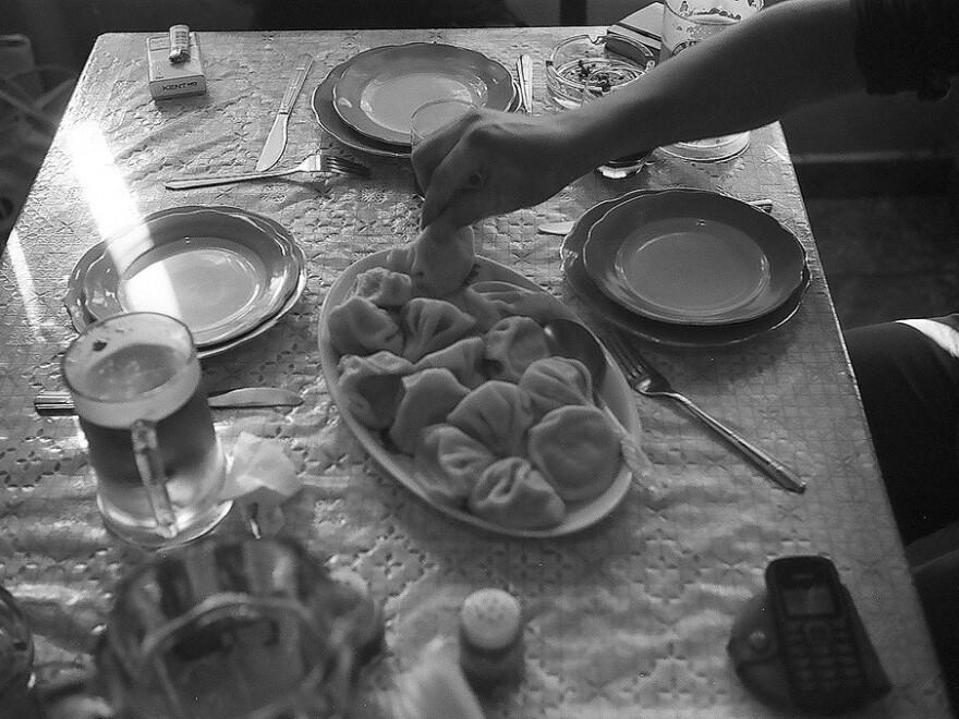 Eating lamb dumplings called <em>khinkali</em> at a table in Tbilisi, Georgia.